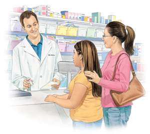 Pharmacist talking to woman and girl at pharmacy counter.