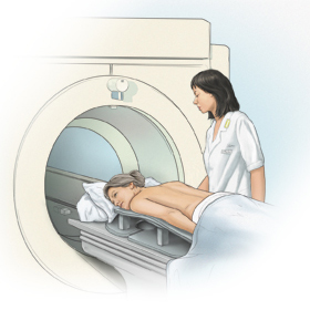 Woman is lying face down on MRI table. Table is ready to go into MRI tube. Healthcare provider is standing beside woman.