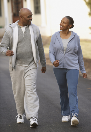 Man and woman walking briskly in comfortable clothes.