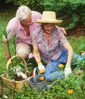 Man and woman outdoors, gardening.