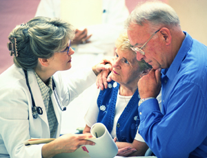 Health care provider talking to man and woman.