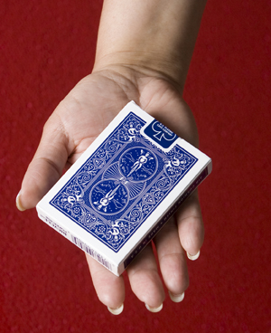Hand holding a deck of cards.