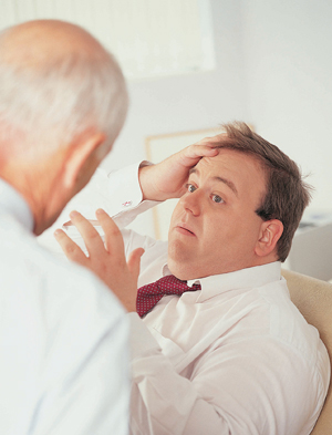 Obese man talking to health care provider.