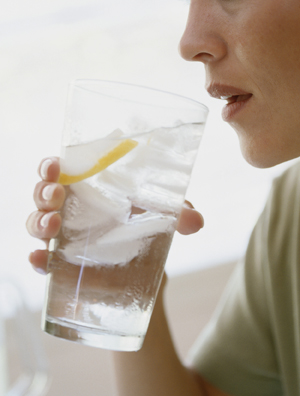 Woman drinking large glass of water.