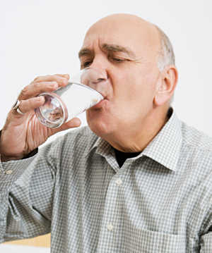 Man drinking glass of water.