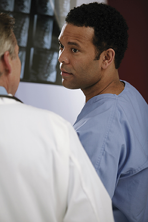 Doctor consulting with male patient.
