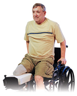 Man with amputated leg sitting in wheelchair doing seated pressup.