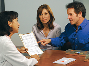 Man and woman consulting with health care provider.
