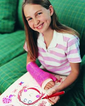 Female child with an arm cast drawing.