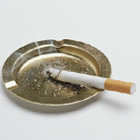 Cigarette in ashtray.