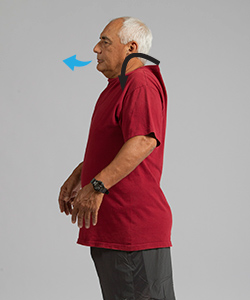 Man breathing out while doing shoulder roll exercise.
