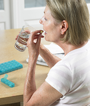 Woman taking low-dose aspirin.