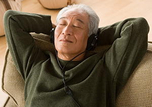 Man relaxing with headphones on.