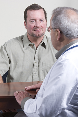 Man in consultation with a healthcare provider.