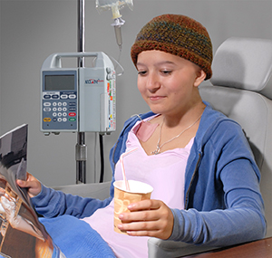 Teen girl having infusion treatment.