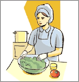 Cook in kitchen wearing gloves and making salad.