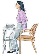 Woman holding onto chair arms instead of walker and getting ready to sit down.