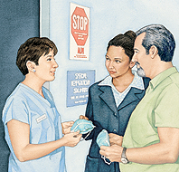 Health care provider giving masks to man and woman.