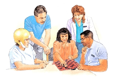 Woman and man sitting at table playing checkers. Man in helmet , another man, and healthcare provider are looking on.