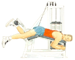 Man lying on stomach on exercise weight machine. He is using back of one foot to push bar attached to weights.